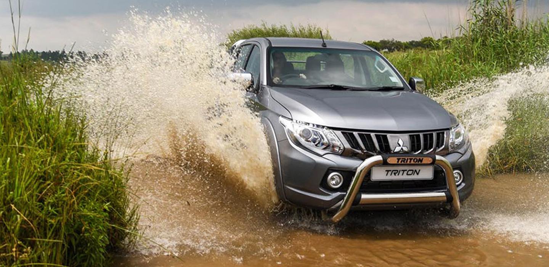 Mitsubishi Triton Driving Through Water