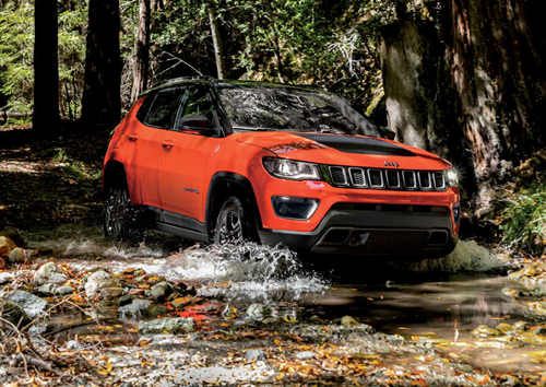 Orange Jeep Compass Driving Through Water